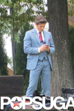 James Marsden took a quick cell phone break while decked out in '70s gear.