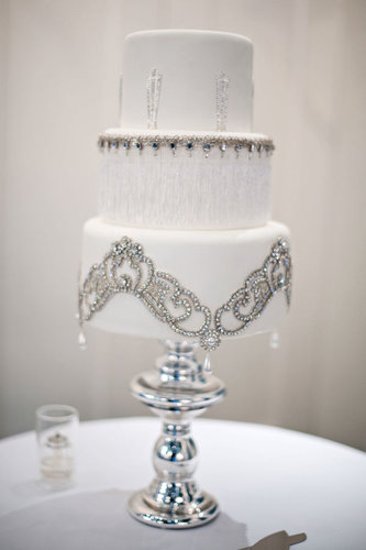 This romantic cake is practically dripping in elegance with its delicate details.  Photo by Kristen Weaver Photography via Style Me Pretty