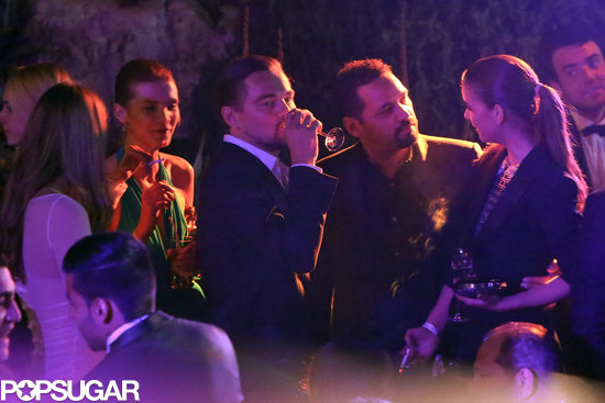 Leonardo DiCaprio had a drink while surrounded by beautiful women at a Cannes Film Festival party.