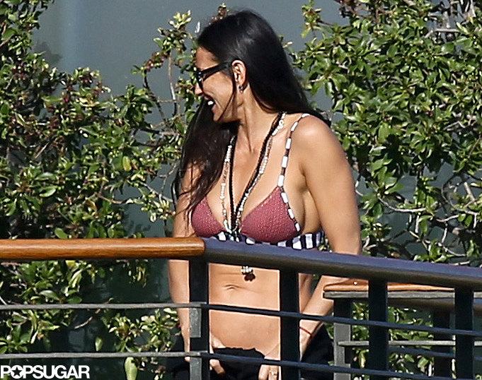 Demi Moore wore a bikini at friend Harry Morton's home.