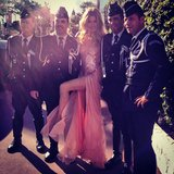 Doutzen Kroes posed with a group of French police officers in a beautiful pink Versace gown. Love the thigh-high slit! Source: Instagram user doutzenkroes1
