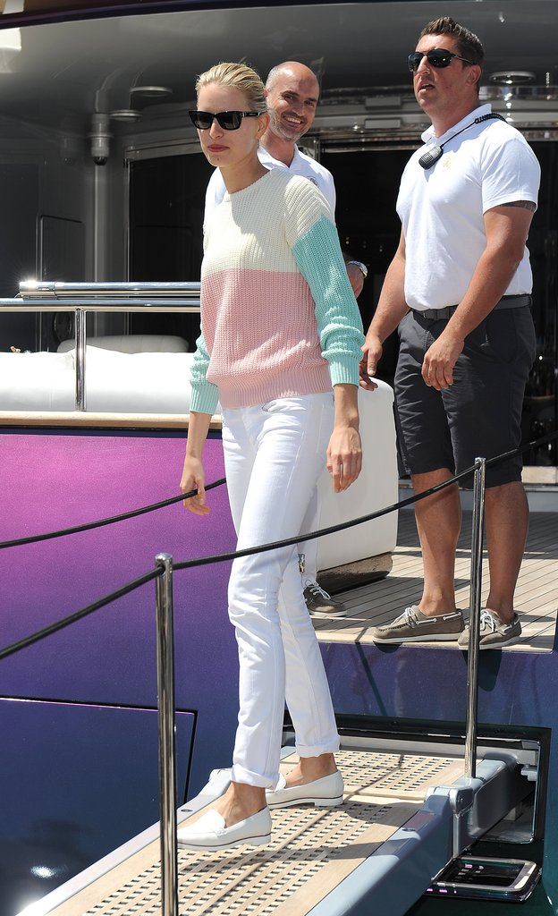 While boarding a yacht in Cannes, Karolina Kurkova gave her white denim a preppy spin thanks to white loafers and a colorblocked sweater.