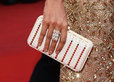 Rosario Dawson carried a white Ferragamo clutch.