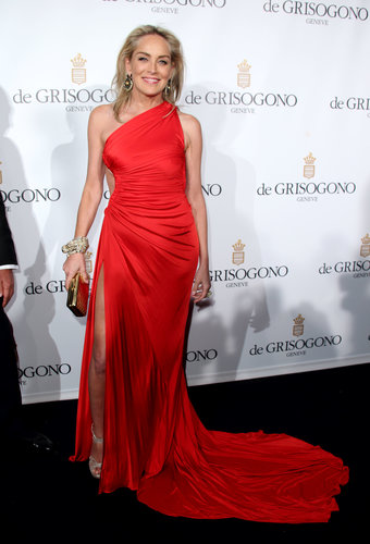 Sharon Stone celebrated at the de Grisogono party in a red-hot, one-shoulder Roberto Cavalli gown.