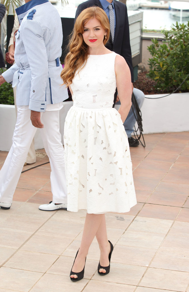 Isla Fisher looked feminine in her white Dolce & Gabbana fit-and-flare dress at the Great Gatsby photocall in Cannes.