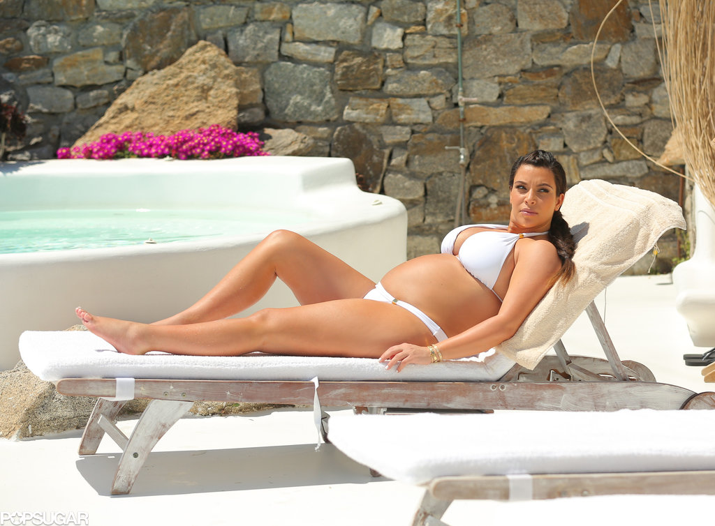 Kim Kardashian tanned by the pool in Mykonos, Greece.