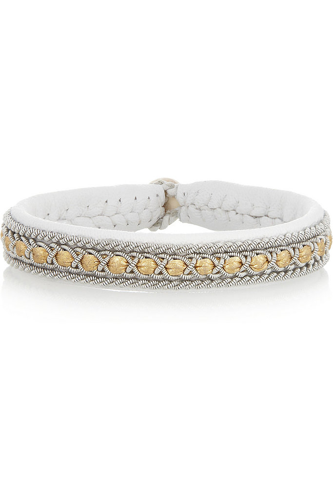 A friendship bracelet for adults, this white leather Maria Rudman find ($225) will go with everything and serve as a constant reminder of a fun weekend.