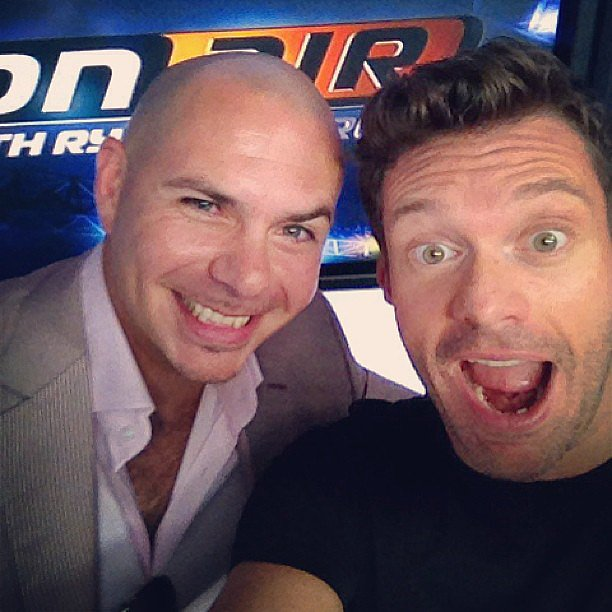 Ryan Seacrest snapped a selfie with Pitbull when the rapper stopped by Ryan's radio