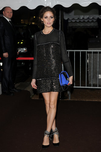 Once we tore our eyes away from the sparkly shift Olivia Palermo choose for the Cavalli party, we were delighted by her accessories: a bright blue bag and feather-accented pumps!