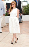 Isla Fisher was fresh in a white Dolce & Gabbana fit-and-flare dress at the Great Gatsby photocall in Cannes.