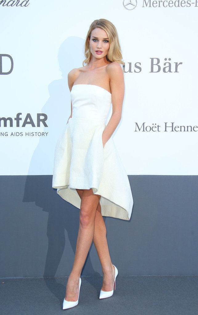 Rosie Huntington-Whiteley took a shorter approach than the rest of the amfAR attendees in a little white Dior strapless bustier and skirt with matching white Christian Louboutin pumps.
