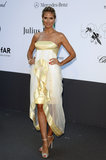 Heidi Klum's strapless gold ruffle Marchesa dress accentuated her svelte décolletage and glowing skin.