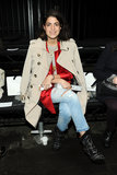 Take a lesson in layering from Leandra Medine: sweater + satin blazer + classic trench.