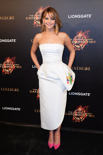 Jennifer Lawrence made a fun pairing with a white strapless peplum Dior dress and hot-pink pumps at the Hunger Games: Catching Fire premiere at Cannes.