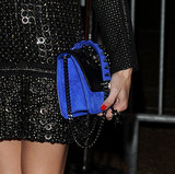 Olivia Palermo carried a royal-blue-and-black studded bag.