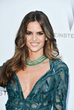 Model Izabel Goulart mastered a sexy duo: voluminous waves and a smoky eye.