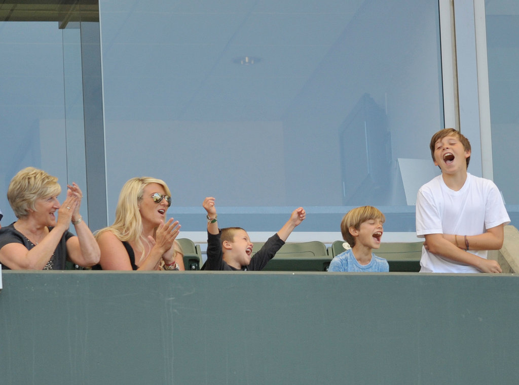 Brooklyn, Romeo, and Cruz Beckham went wild in the stands with David's mom Sandra and sister Joanne during a July 2011 game in LA.