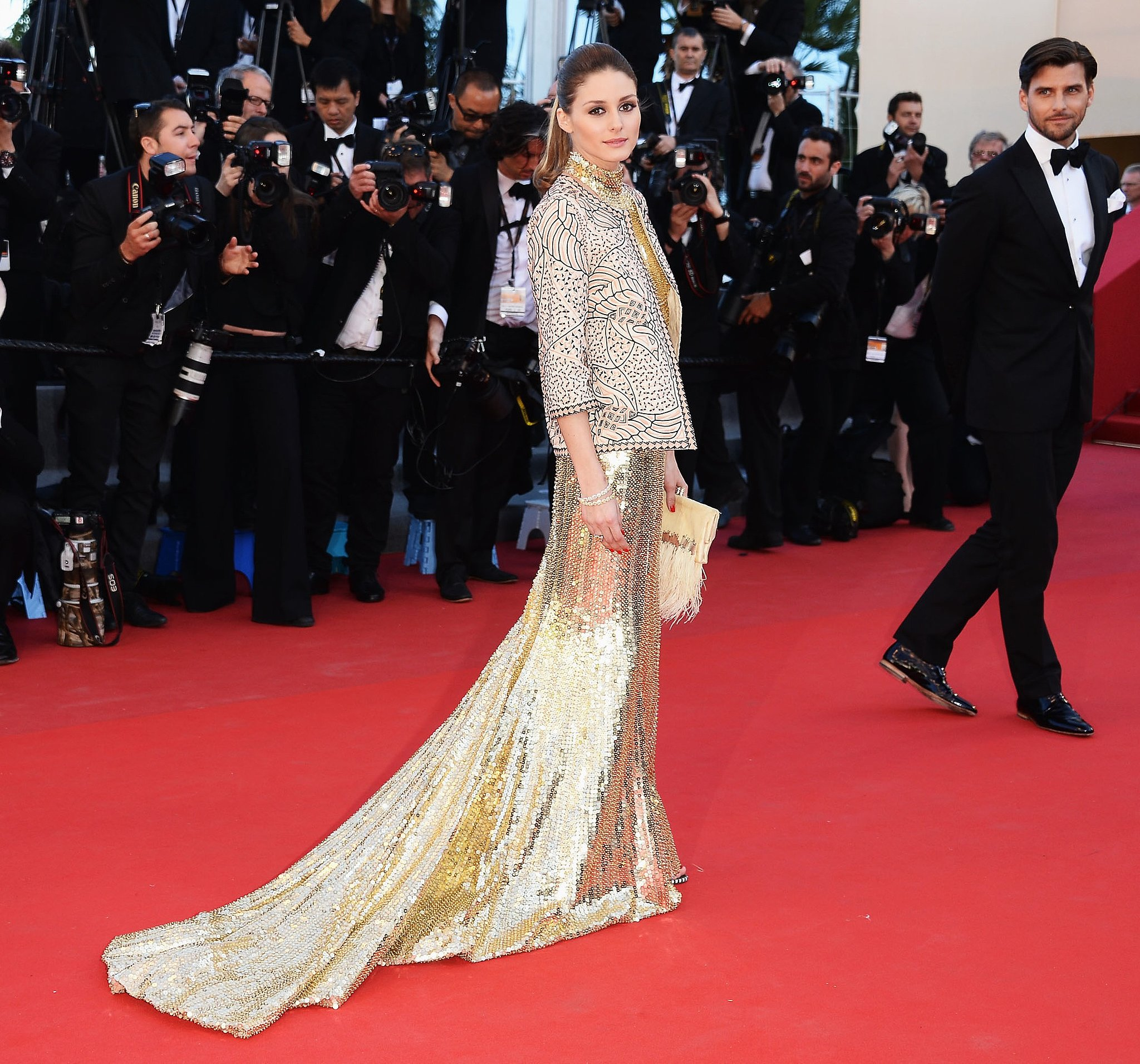 At the premiere of The Immigrant at Cannes, Olivia Palermo glowed in a gold sequined gown, topped with an exquisite jacket and finished with a feathery clutch.