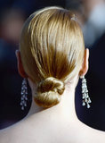 And Uma's her hair was tied up in a twisted, sleek knot for the event.