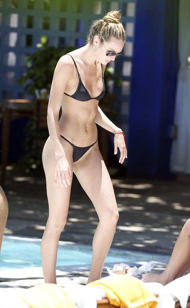 Candice Swanepoel wore a skimpy black bikini poolside in Miami on Saturday.