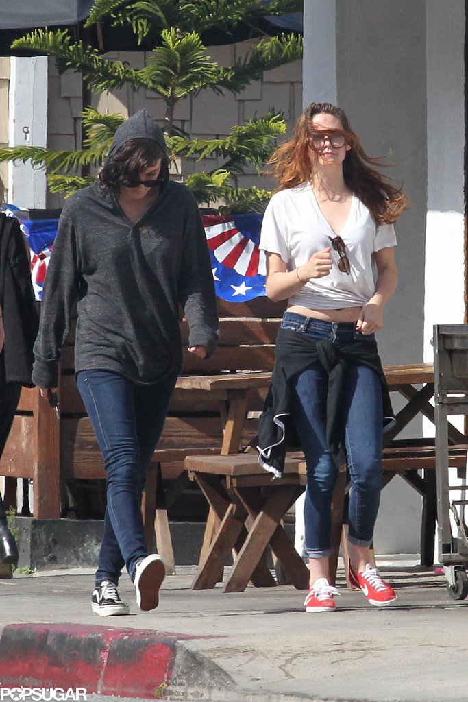 Kristen Stewart skipped alongside a friend.