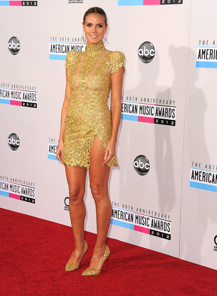 Klum went for the gold in a gilded Alexandre Vauthier Couture minidress and coordinating pumps at the 40th American Music Awards in November 2012. Heidi tempered the mini's ultrasexy slit with a high Victorian-inspired collar and lacy cap sleeves.