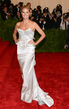 Klum steered clear of the punk chaos theme at this year's Met Gala, opting for a sophisticated structured gown by Marchesa.