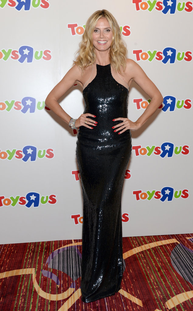 "Paging all glamour girls — Klum rocked it out in a sequined KaufmanFranco column gown and a red hot manicure for the 2012 Toys ""R"" Us Gala in NYC."