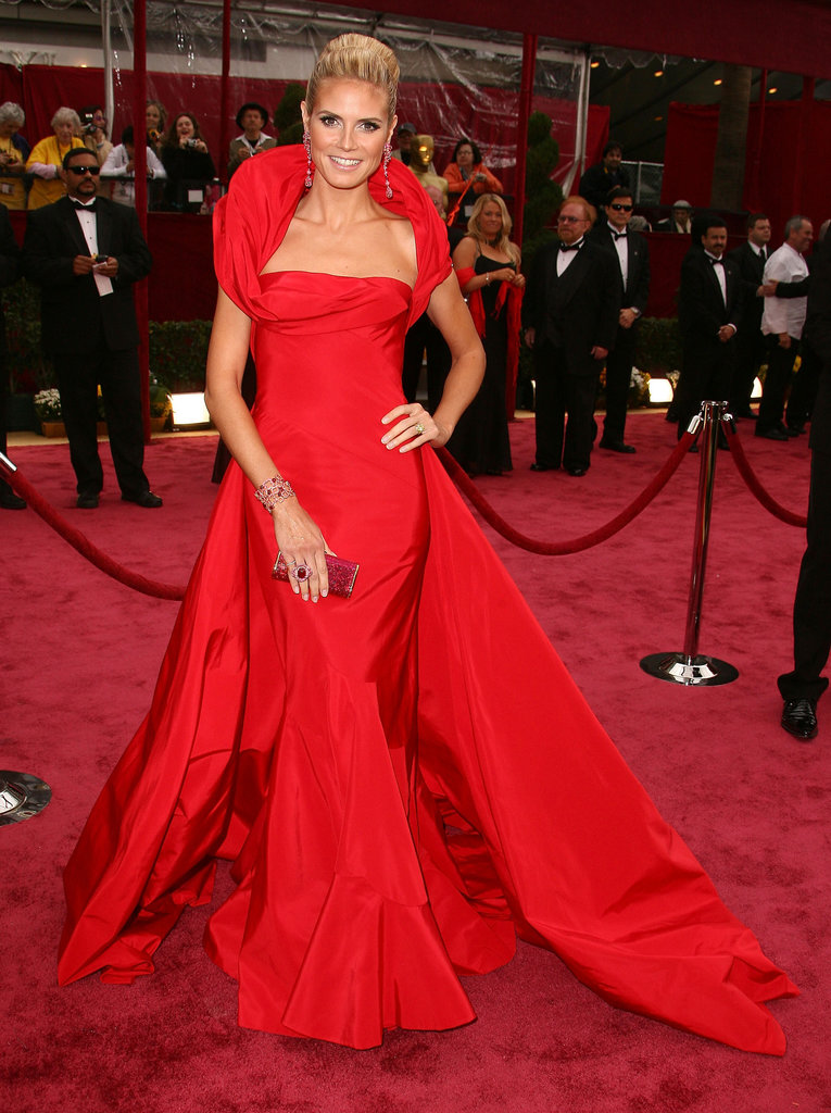 For the 2008 Oscars, Heidi wowed in a draping Cinderella-esque Christian Dior gown. From the high collar to the dramatic train, everything about this fiery confection was fairy-tale perfection.