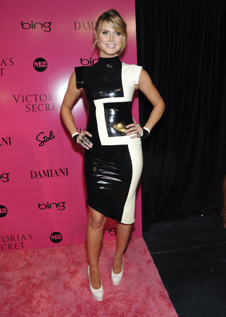 Has latex ever looked so good? Heidi Klum colorblocked in a black-and-white latex dress, matching cuffs, and white pumps for the 2009 Victoria's Secret Fashion Show in NYC.