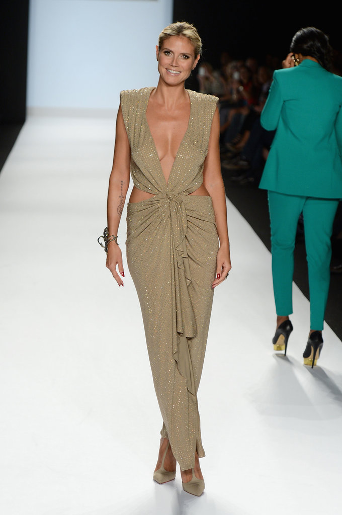 Klum put her model curves on display in a low-cut nude Alexandre Vauthier gown adorned with revealing cutouts, sequins, and a draping back during New York Fashion Week Spring 2013.