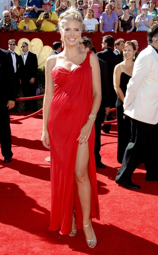The mom-to-be glowed in a fiery one-shoulder Michael Kors creation at the 2006 Emmy Awards in LA. She completed her sweet and sexy look with decedent gold earrings, a coordinating cuff, and dainty sandals.