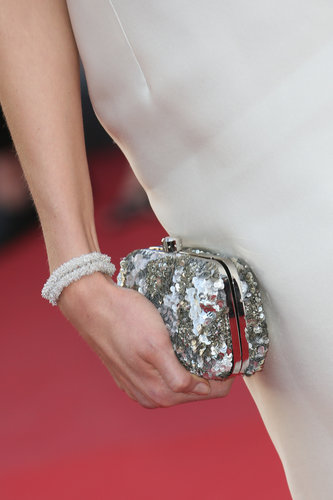 Karlie Kloss carried a silver sequined clutch.