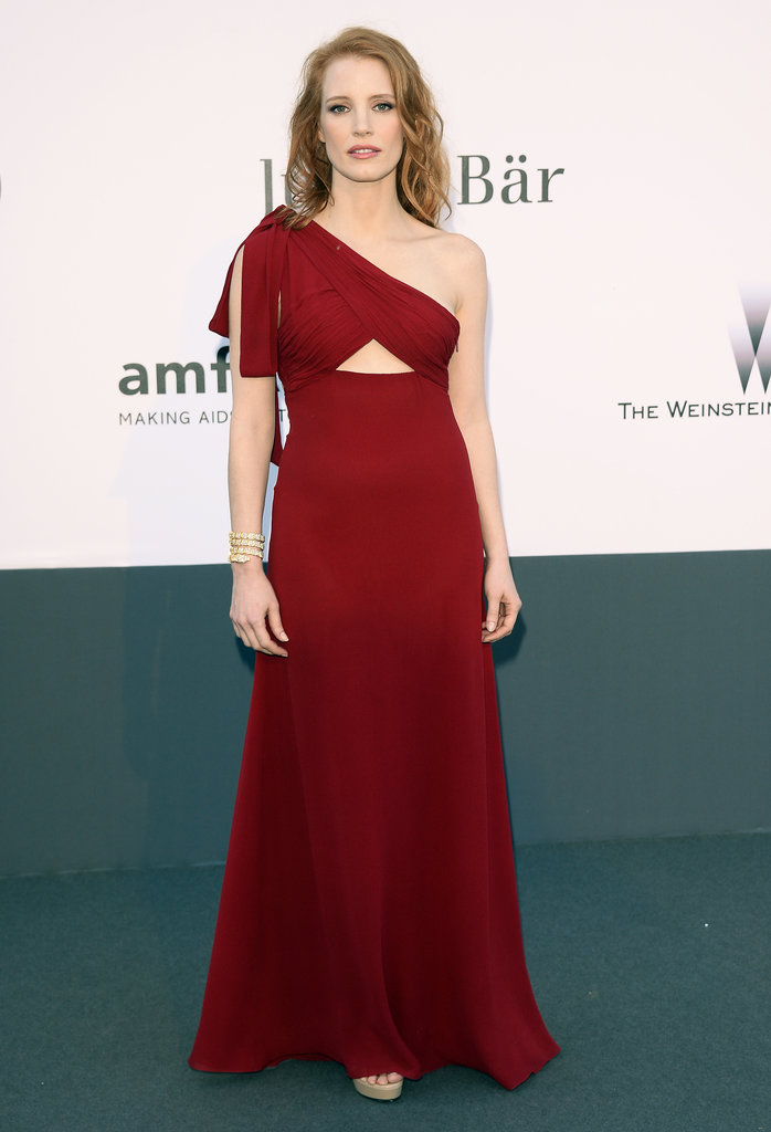 A usually covered-up Jessica Chastain bared a little midriff in this ruby-hued Saint Laurent gown.