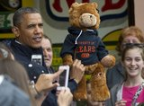 President Obama held up a Chicago Bears teddy bear after playing arcade games with Governor Chris Christie.