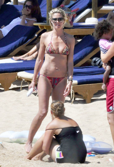 In August 2011, Heidi Klum relaxed on a beach in Sardinia with her family.
