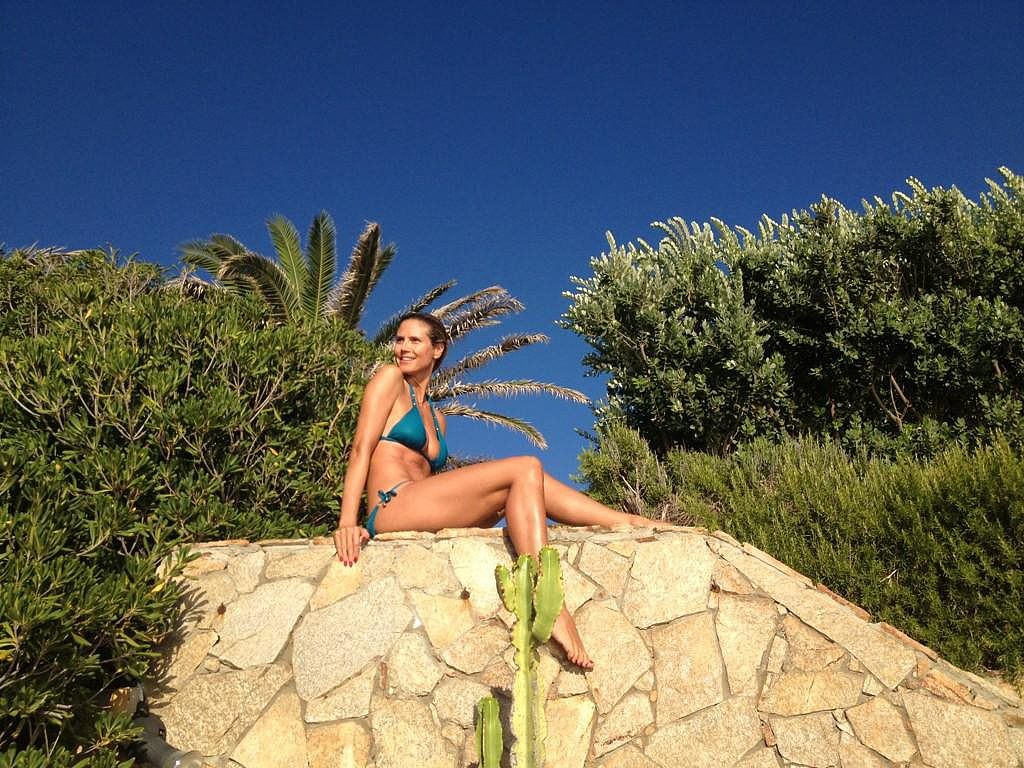 Heidi Klum wore a blue bikini when she perched herself on top of a rock in August 2012. Source: Twitter user heidiklum