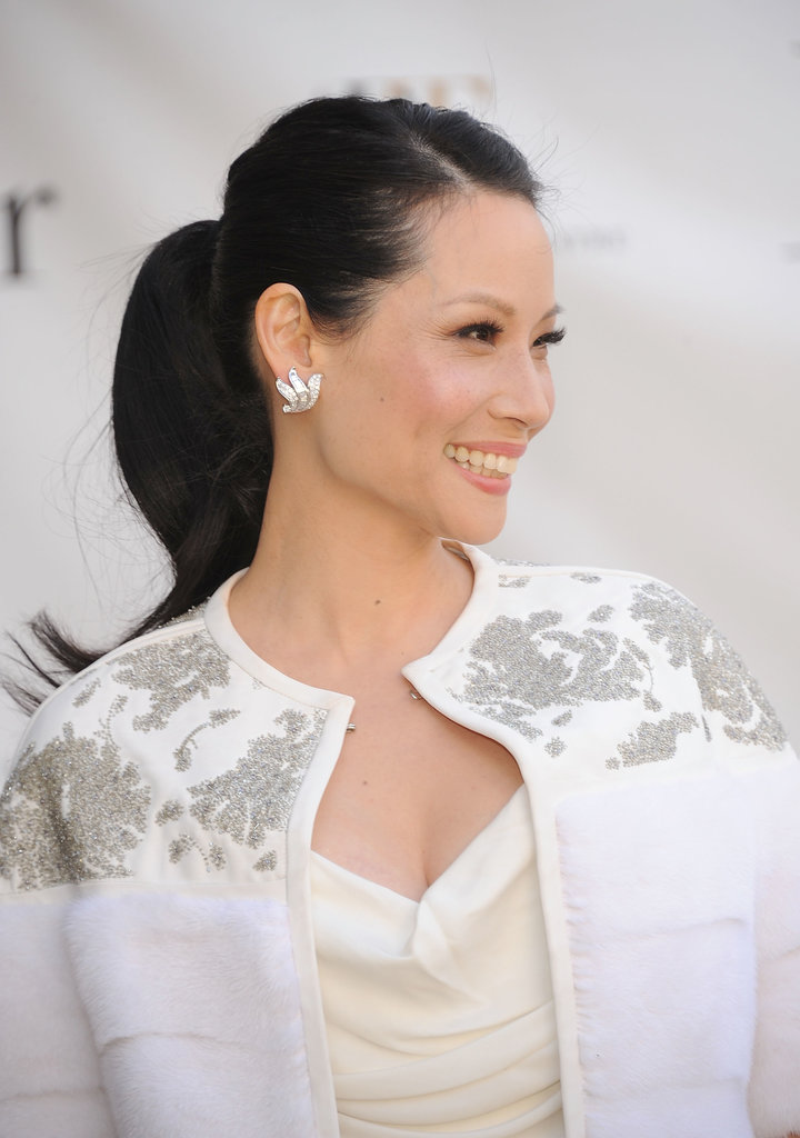 Yes, you can wear a ponytail to a nighttime event. Lucy Liu's sleek look with upturned ends can work for any after-5 affair.
