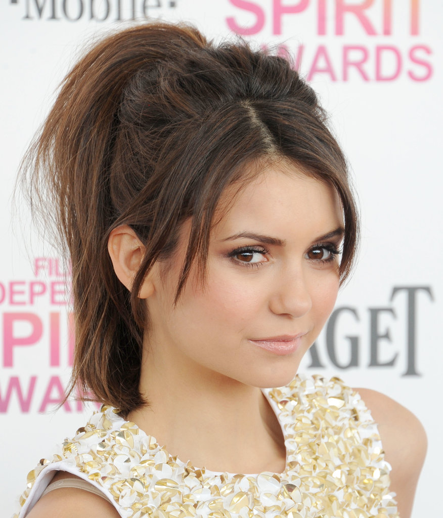 Nina Dobrev showed us the perfect way to wear this casual up 'do. Just tease your roots to achieve her messy texture.