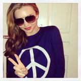 Miranda Kerr flashed a peace sign (while sporting a peace sign jumper). Source: Instagram user mirandakerr
