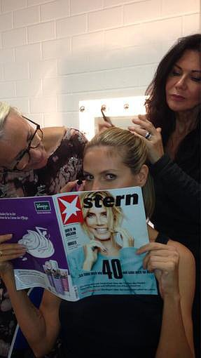 Heidi Klum checked out her German magazine article while getting glammed up. Source: Twitter user heidiklum