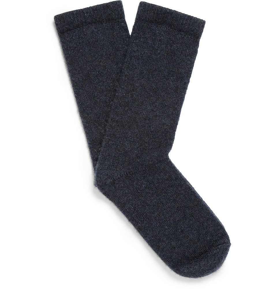 Get comfy for a transatlantic flight. Slip off your shoes and pull on The Elder Statesman's sensuous cashmere socks ($210) — made for him, but oversize enough for a comfortable you.