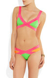 I fell in love with the bubblegum colors and sporty-meets-sexy silhouette of this Agent Provocateur bikini as soon as I saw Nina Dobrev wearing it. Yes, the Mazzi bikini top ($220) and brief bottoms ($170) certainly give way to showing off a lot of skin, but the neon palette makes it downright fun.  — MT