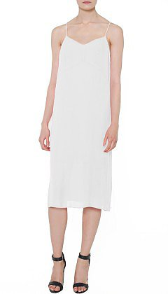 """The temperatures are rising, and I can't think of anything better to wear than this Tibi slip dress ($310). It's aptly name the """"perfect slip dress,"""" and I can't wait to wear it with a light vest and nude sandals for a day at work and with bold gold jewels later into the evening.  — CDC"""