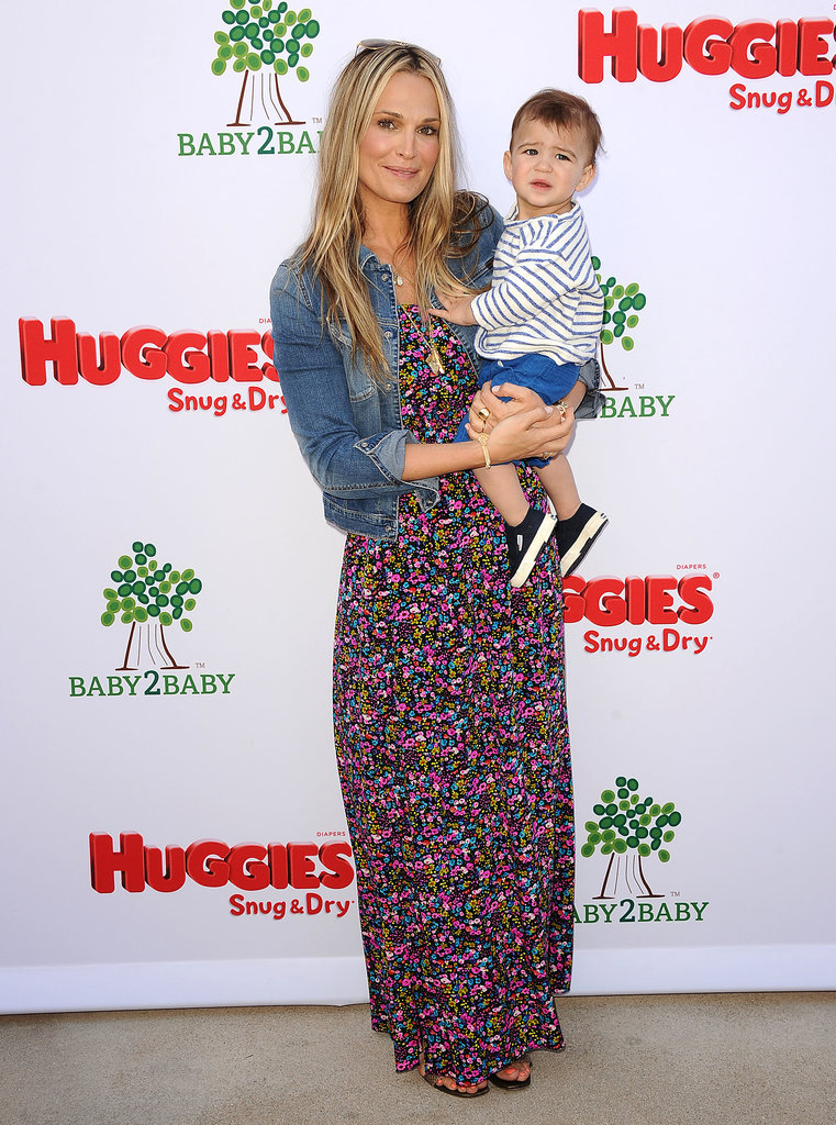 Molly Sims tempered her busy floral maxi dress with a denim jacket at a Baby2Baby event in LA.