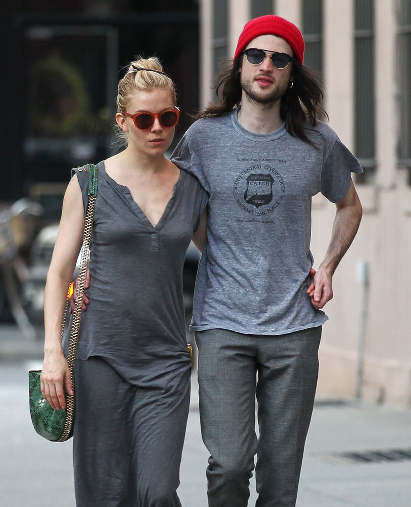 Sienna Miller had her arm around fiancé Tom Sturridge for an NYC stroll.