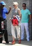 Gwen Stefani left Joel Silver's Memorial Day party in a striped tank, white cropped trousers, and bold red accessories.