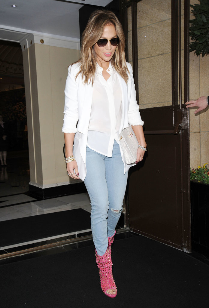 Jennifer Lopez was undeniably fresh in a white blouse, a white blazer, light-wash skinny jeans, and a pair of studded pink peep-toe boots.