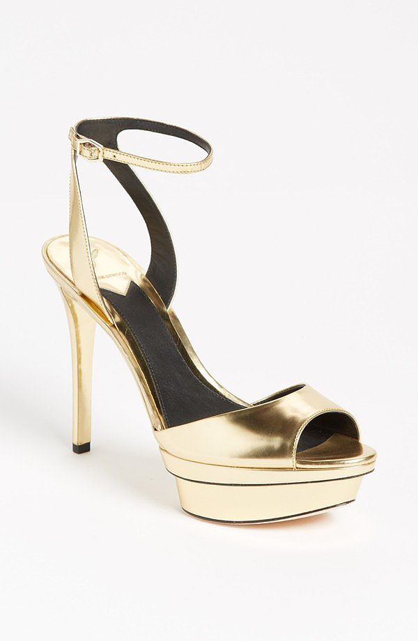 Instead of opting for a traditional white heel, go for gold in these sleek B Brian Atwood gold ankle-strap sandals ($325).