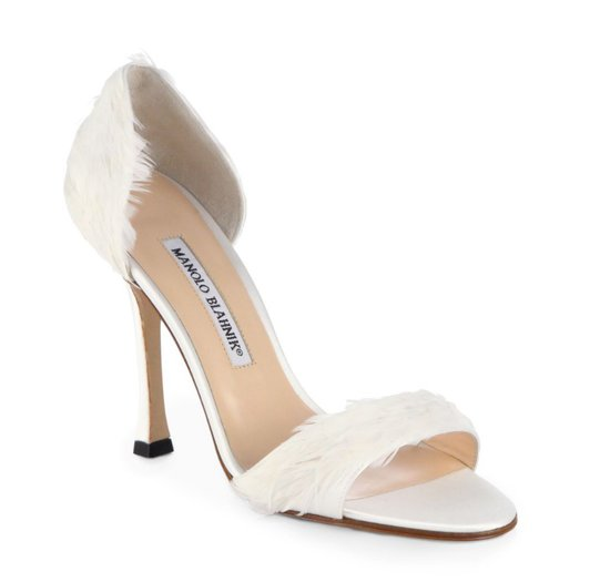 The feathers on these Manolo Blahnik d'Orsay pumps ($825) add an overtly feminine element. For that reason alone, we think this pair would look great with a shorter-hemmed dress. That way, you can really showcase the subtle surprises on the pump.